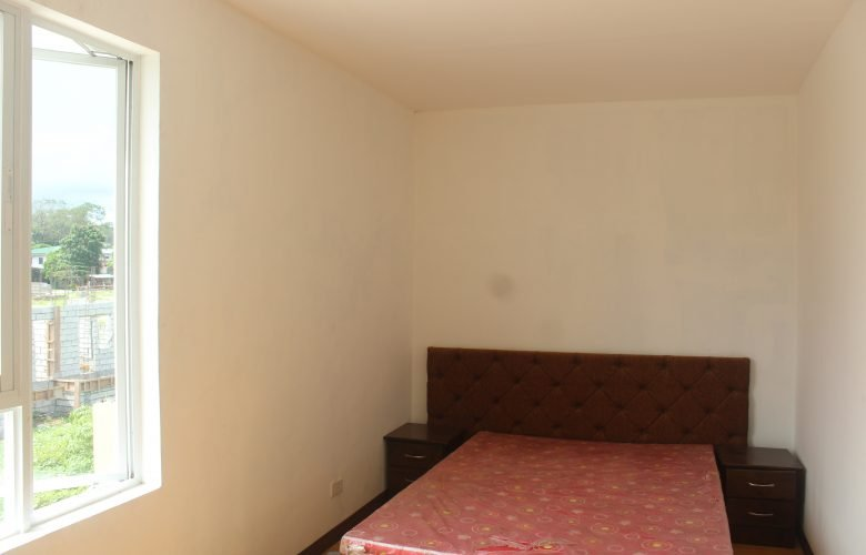 Bedroom of a Buena Rosario Town House in Cabuyao, Laguna